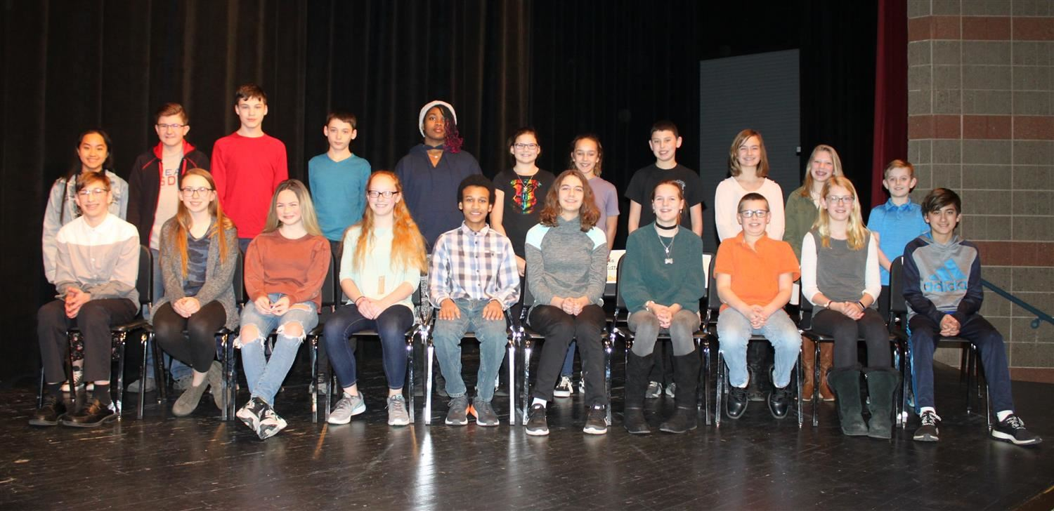 Middle School Spelling Bee finalists.  Picture includes 18 students in two rows.