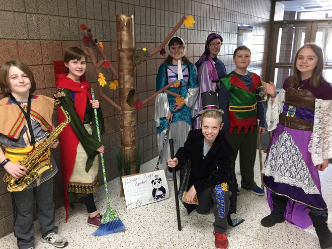 Picture of Destination imagination team.  Students dressed in medieval costumes with a homemade tree.